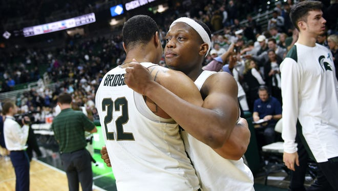 Michigan State's Cassius Winston, right, hugs Miles Bridges after the Spartans victory over Penn State on Wednesday, Jan. 31, 2018, at the Breslin Center in East Lansing. Michigan State won 76-68.