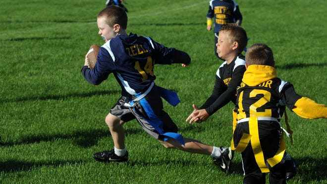Brady Zell of the Mini Lasers makes a break down field during the KMRA Lightning division title Saturday, Oct. 19, 2013 at Ottawa Park.
