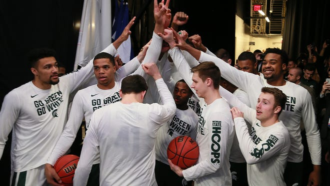 Michigan State gets together in the tunnel before they take the court in the second round of the NCAA tournament against Syracuse at Little Caesars Arena on Sunday, March 18, 2018.