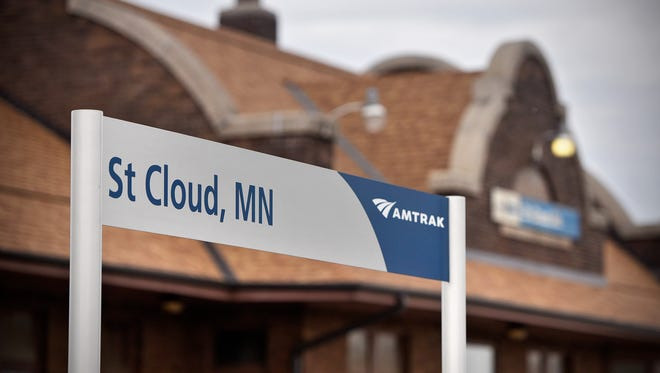 Amtrak signs are posted outside the depot building along the track in April 2017 in St. Cloud.