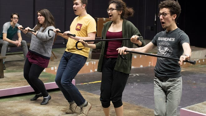 """Musical theater students (from left) Colin Sullivan, Jaclyn Janowski, Christof Krumenacker, LeAnne Bavers and Drew Swenson rehearse scenes from """"Jacques Brel is Alive and Well and Living in Paris"""" in the UW-Stevens Point studio theatre. The musical revue will be staged Feb. 10-12 and 15-18."""