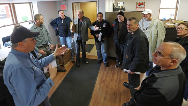 Dan O'Brien, far left, of Academy Electric, leading a discussion with business owners concerned about Emerson redevelopment.