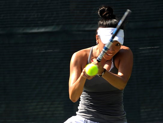 Chelsea Kung returns a ball during her match against