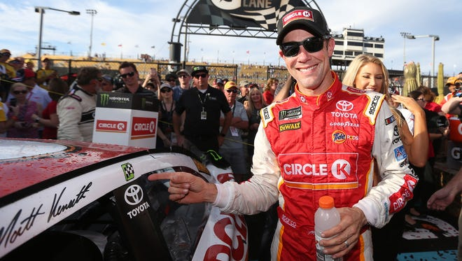 Matt Kenseth, driver of the #20 Circle K Toyota, celebrates after winning the Monster Energy NASCAR Cup Series Can-Am 500 at Phoenix International Raceway on November 12, 2017 in Avondale, Arizona.