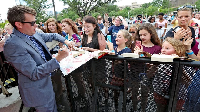 """Paper Towns"" author John Green signs autographs Tuesday, July 14, 2015, along the red carpet at Old National Centre. The ""Get Lost Get Found"" tour to promote the film ""Paper Towns"" made its first stop this week in Indianapolis, Green's hometown. The film arrives in theaters on July 24."