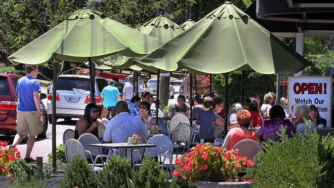 The Illinois Street Food Emporium's patio is a prime people-watching location. The Emporium is one of the oldest continuously operating establishments on the 5500 block of Illinois Street in the Butler-Tarkington neighborhood.