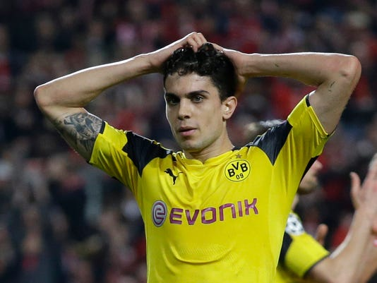 "FILE - In this Feb. 14, 2017 fie photo, Dortmund's Marc Bartra reacts during the Champions League round of 16, first leg, soccer match between Benfica and Borussia Dortmund in Lisbon. Marc Bartra, who was wounded in an attack on the team bus of German soccer club Borussia Dortmund Tuesday, April 11, 2017 said Friday April 14, 2017 the experience was the ""hardest 15 minutes"" of his life. (AP Photo/Armando Franca, FILE)"
