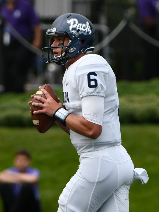 Nevada quarterback Ty Gangi (6) looks to pass against Northwestern during the first half of an NCAA college football game in Evanston, Ill., Saturday, Sept. 2, 2017. (AP Photo/Matt Marton)