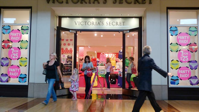 In this Nov. 12, 2010 photo, shoppers walk past a Victoria's Secret store, in Des Peres, Mo.