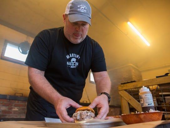Pitmaster Pat Martin prepares a Martin's Bar-B-Que