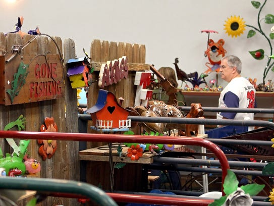 Arts Alive! Home & Garden Festival attendees look at