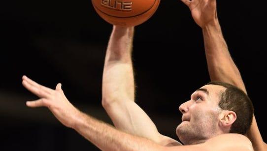 University of Evansville forward Blake Simmons goes