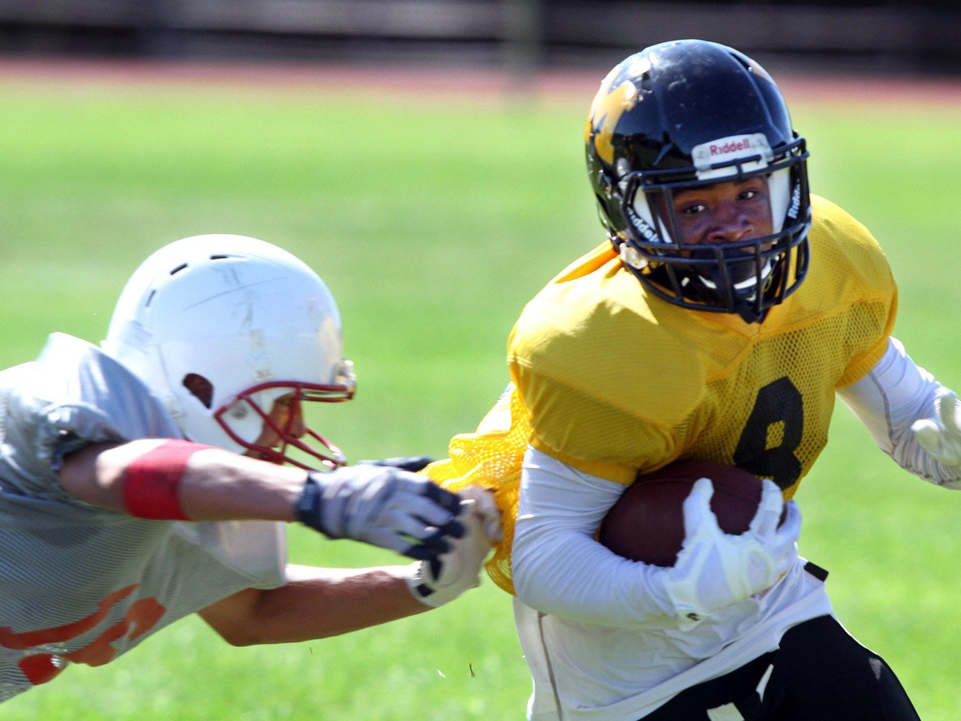 Monmouth's Malik Wiggins tries to escape a Jackson Liberty defender during a scrimmage Aug. 28.