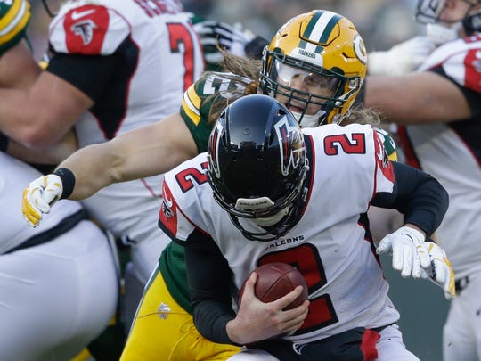 Packers linebacker Clay Matthews sacks Falcons quarterback Matt Ryan during a December 2018 game at Lambeau Field.