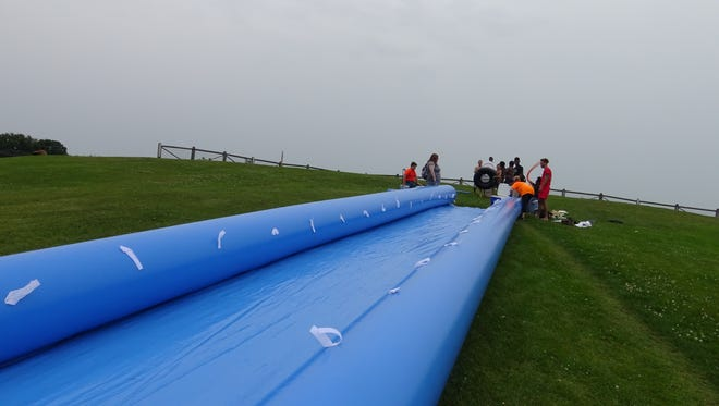 A 200-foot slip-and-slide will be featured Saturday, Aug. 5, 2017, at Splashkosh, a new festival in Oshkosh.