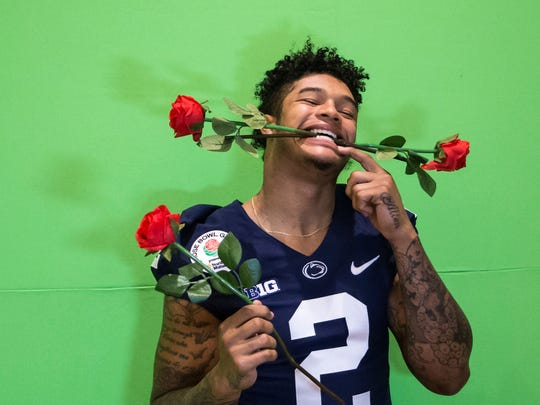 Penn State safety Marcus Allen hams it up while getting