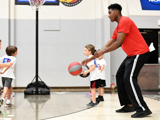 Keagan Schmitt (l) works on bounce pass drills with Union University graduate Ashanti Day (r) during the pee wee summer basketball camp, Monday, June 5.