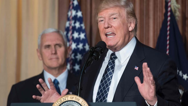 President Donald Trump speaks before signing the Energy Independence Executive Order at the Environmental Protection Agency Headquarters in Washington, D.C., on March 28, with Vice President Mike Pence. The Trump administration's indecisiveness on issues from regulation to immigration to health care has left businesses unable to plan for the future, argues Washington Post columnist Catherine Rampell.