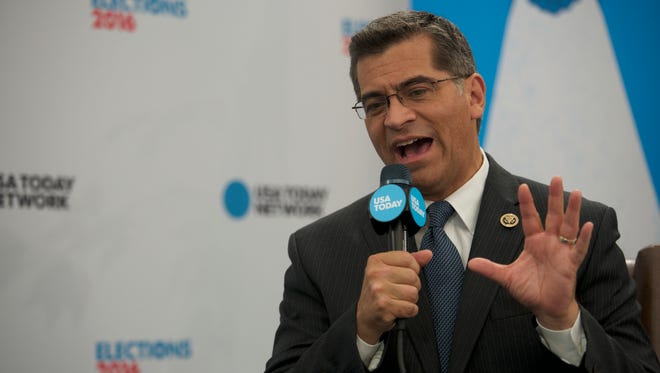 Rep. Xavier Becerra, D-Calif., talks with USA TODAY Washington Bureau Chief Susan Page during the Democratic National Convention.