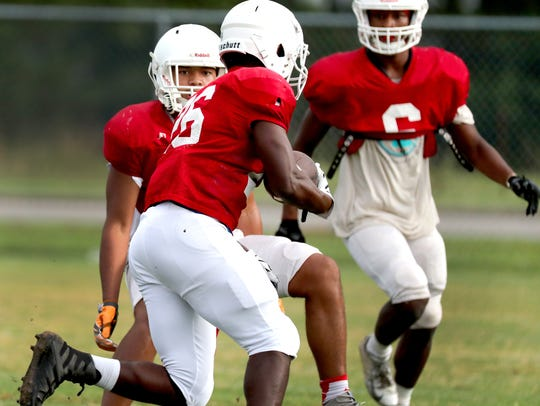 Xavier Myers (26) runs the ball during the first day
