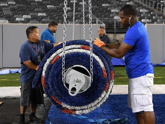 MetLife Stadium operations crew members secure the