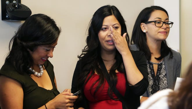 """""""Dreamer"""" Korina Uribe ( in Red) reacts with tears after hearing the ASU Board of regents decision after their Thursday meeting as seen in Phoenix on May 7, 2015"""