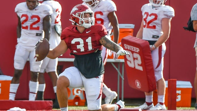Razorback redshirt senior linebacker Grant Morgan (#31) from Greenwood runs through a fumble recovery drill at the Willard & Pat Walker Pavilion in Fayetteville.
