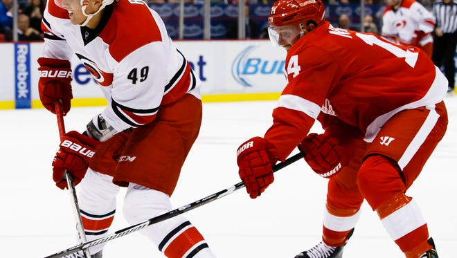 Hurricanes center Victor Rask takes a shot defended by Red Wings center Gustav Nyquist in the third period at Joe Louis Arena on Friday.
