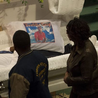 Mourners file past the casket of Freddie Gray during