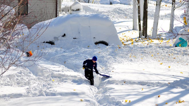 Drew Ahmed makes his way through nearly five feet of snow on Nov. 19, 2014 in the Lakeview neighborhood of Buffalo, New York.