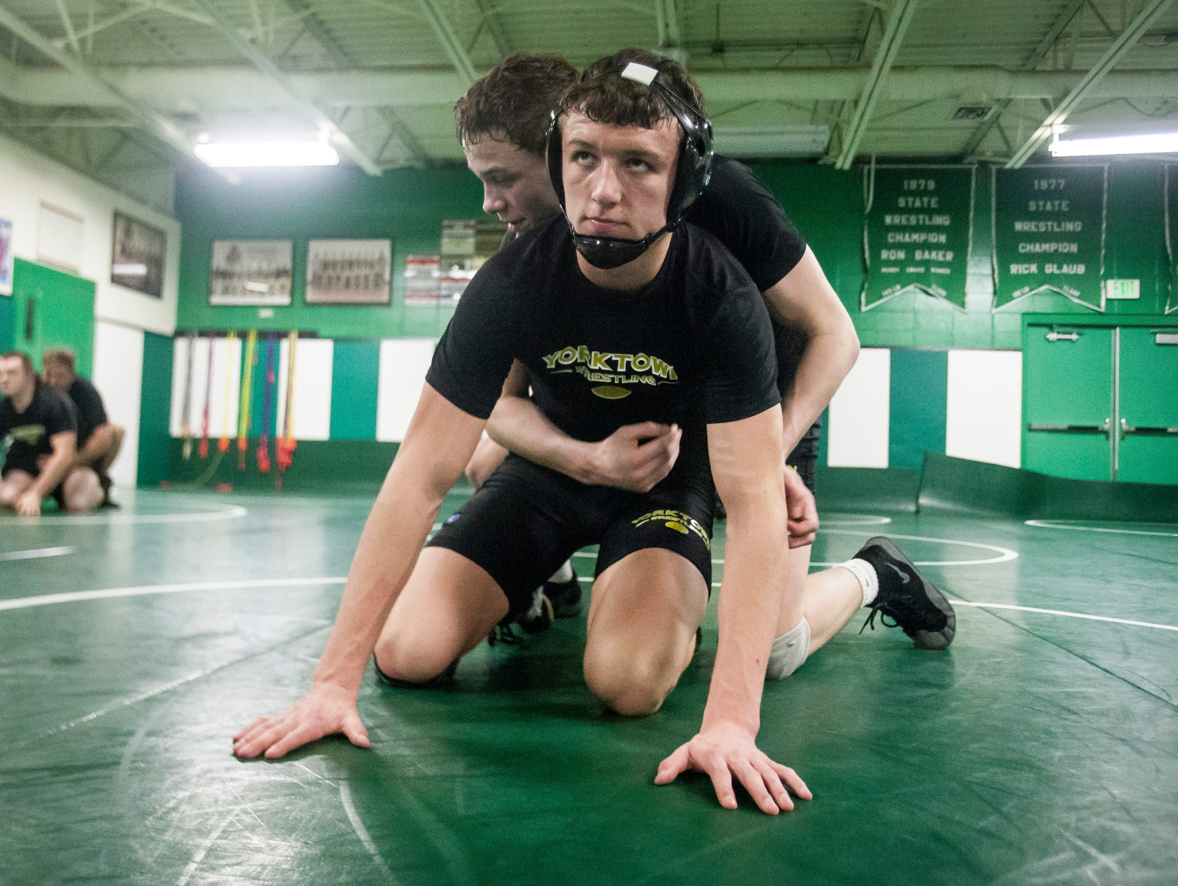 Cael McCormick practices with another Yorktown wrestler at Yorktown High School. This season will be McCormick's last for his high school career.