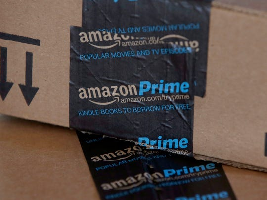 FILE - This June 4, 2014 file photo shows Amazon boxes in Phoenix. Amazon reports quarterly financial results on Thursday, July 23, 2015. (AP Photo/Ross D. Franklin) ORG XMIT: NYBZ109