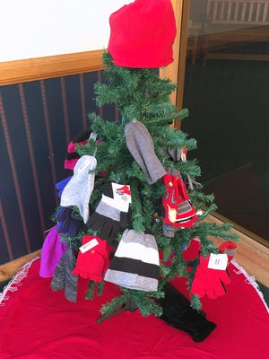 A mitten tree sits in the lobby of the Ziff Law Firm in Elmira.