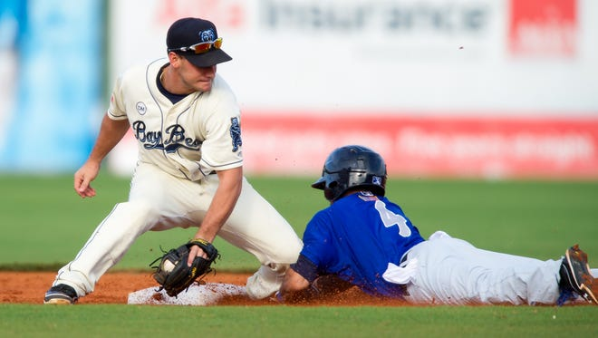Billy Hamilton of the Pensacola Blue Wahoos slides safely into second base as Chris Ownings  of the Mobile Baybears attempts to tag him out at Hank Aaron Stadium on August 17, 2012 in Mobile, Alabama. Billy Hamilton is set to break the minor league record of 145 stolen bases currently held by Vince Coleman of Macon Redbird's 1983 team.