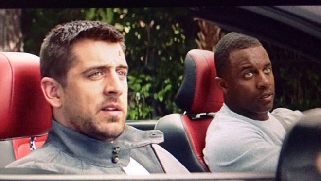 Green Bay Packers players Aaron Rodgers, left, and Randall Cobb star in a new State Farm commercial that aired on Thanksgiving Day.