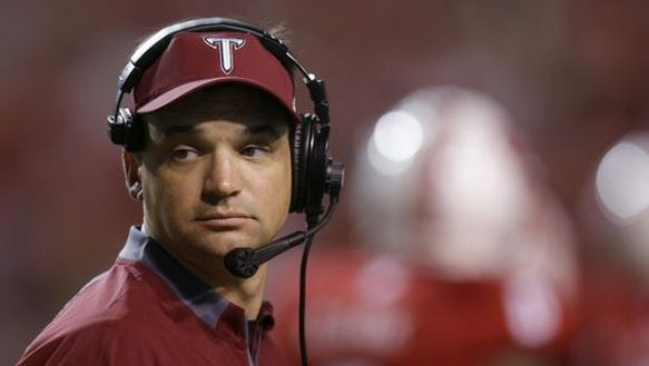 Troy coach Neal Brown looks on during the second half