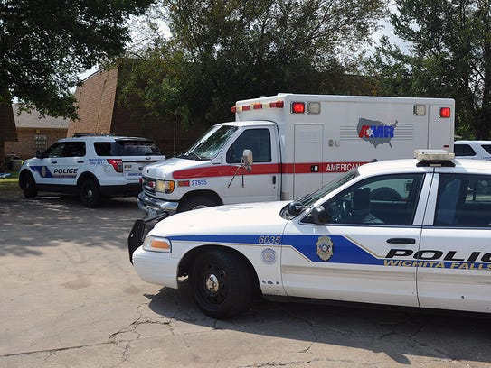Wichita Falls Police and emergency medical personnel