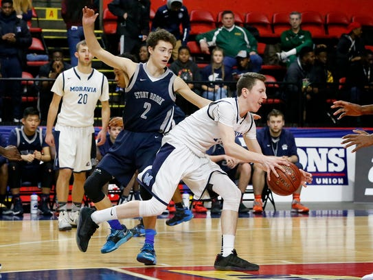 Moravia's Kaleb Stayton rushes past several Stony Brook