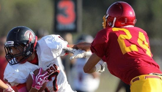 Rio Mesa'€™s Jaedon Rogers intercepts a pass intended for Oxnard'€™s David Benavides.