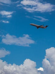 A SkyWest flight headed to Denver takes off from the