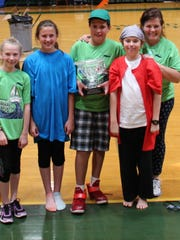 Wardlaw-Hartridge sixth-graders sailed in the annual Cardboard Regatta to mark the end of the school year. The winning SS Jolly Rogers team. Left to right: Olivia Brown, Sydney Sweeney, Will Granados and Justyn Niemczyk, received the trophy from Tanda Tucker.