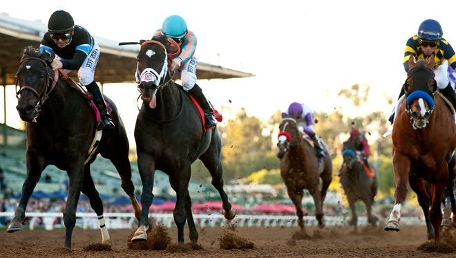 Shared Belief and jockey Mike Smith, left, overpower Conquest Two Step (Joseph Talamo), second from left, to win the Grade I, $300,000 Malibu Stakes, Friday at Santa Anita Park. © BENOIT PHOTO