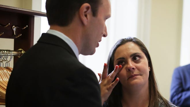 Erica Smegielski, daughter of slain principal Dawn Hochsprung of Sandy Hook Elementary School, is comforted by U.S. Sen. Christopher Murphy, D-Conn., after votes on gun control Monday. The Senate failed to pass four competing amendments on gun control just a week after the nation's worst mass shooting in modern history at a gay nightclub in Orlando, Florida.