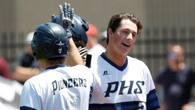 Providence High School's Jake Lewis (2) celebrates with Parker Graf (7) after scoring a run against Austin High School during their game at Providence High School in Clarksville, Indiana.   June 3, 2017