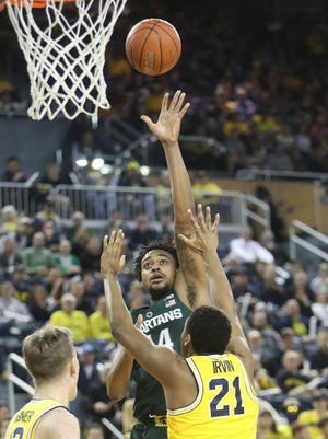Michigan guard Zak Irvin defends against Michigan State forward Nick Ward during the first half Tuesday at Crisler Center.