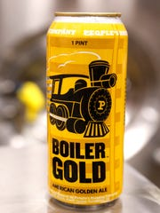 A pint of Boiler Gold American Ale fresh off the canning