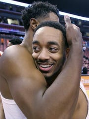 Clemson's Marcquise Reed, right, hugs a teammate after Clemson defeated Florida 71-69 during an NCAA college basketball game at the Orange Bowl Basketball Classic tournament, Saturday, Dec. 16, 2017, in Sunrise, Fla. (AP Photo/Luis M. Alvarez)