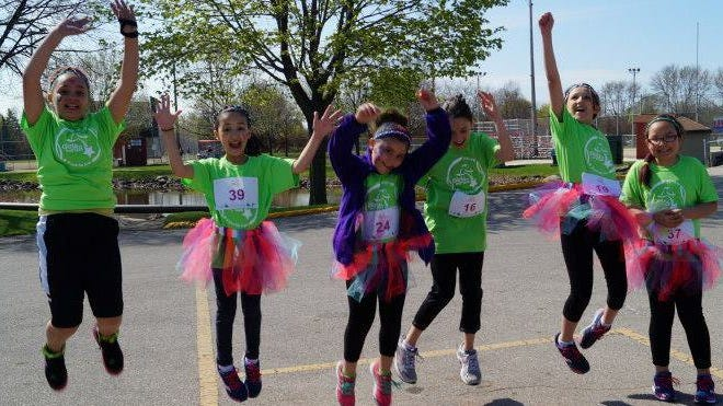 "The Fond du Lac School District's ""Girls on the Run,"" a positive youth development program for girls in third to eighth grades, received a $1,250 Fond du Lac Area Women's Fund grant. A group of girls are shown warming up for a run."