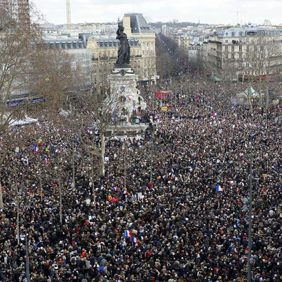 Thousands gather on the Place de la Republique  in