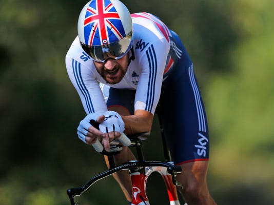 FILE - In this file photo dated Wednesday Sept. 24, 2014, world champion Britain's Bradley Wiggins competes to win the men's individual time trial event at the Road Cycling World Championships in Ponferrada, north-western Spain.  Wiggins is leaving the Sky team that turned him into a Tour de France champion, and during a press conference Friday April 10, 2015, he wasn't feeling chatty at all and abruptly announced that he wouldn't be speaking after all.  (AP Photo/Daniel Ochoa de Olza, FILE)